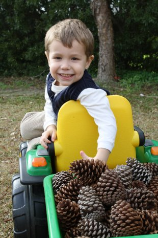 Jackson loves working with his John Deere Tractor
